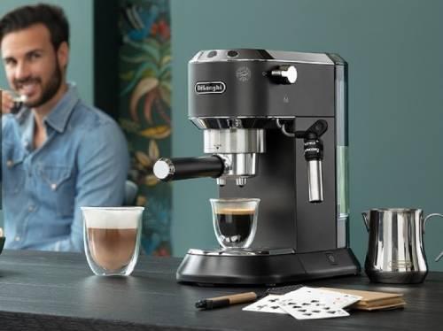 a man enjoying a cup of espresso